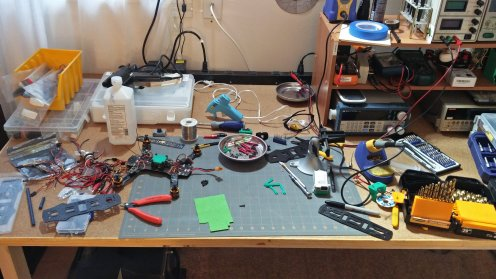 Midway through assembly, the bench is collecting stuff.